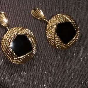 Vintage Monet gold tone/black clip on earrings